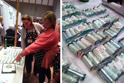 Shop owners Meredith Willet and Alison Hodgkiss look at the new Kreinik metallic thread color, 9032 Easter Braid, which debuted at the February 2013 TNNA trade show.