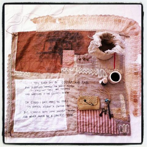 Tara Badcock - 'Hoard; Goods & Chattels' (2013) Hand Embroidered Silk, Hemp, Linen & Cotton, Horsehair Cross Stitched Text, Antique Lace, Transfer Prints and Walnut Husk Dye on Silk, Brass Buttons