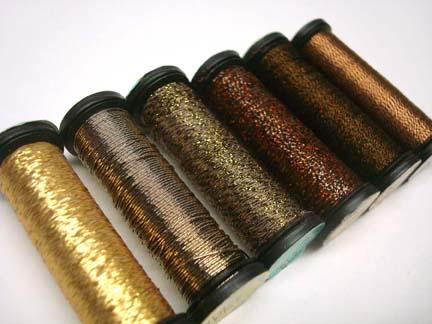Spools of metallic threads