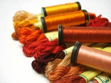 Samples of spun and filament silk threads