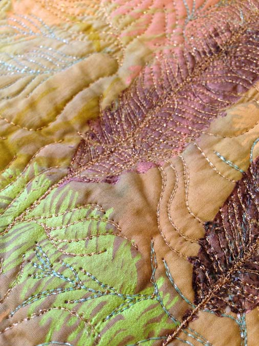 Close up of Sam Packer's feather design showing the metallic machine sewing threads (Kreinik brand).