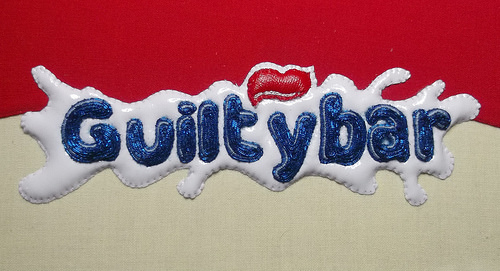 Guilty Bar. Hand embroidery by Charlotte Bailey.