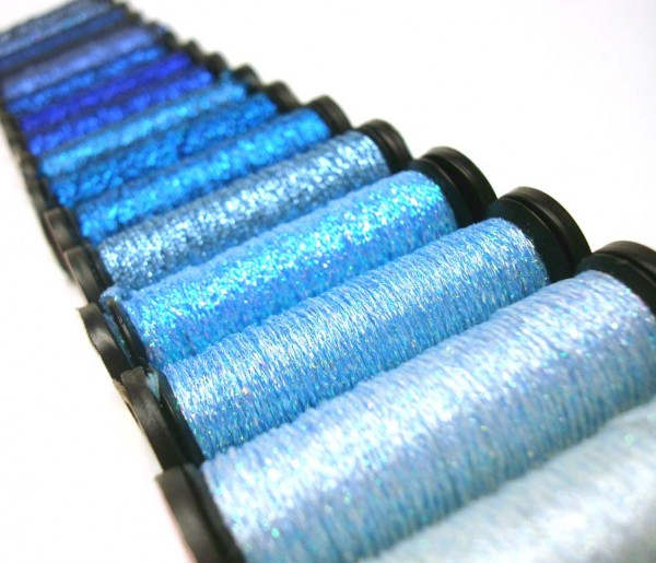The blue thread group covers hues from light to dark, from pastel to jewel tones, with a few variegated blends in between.