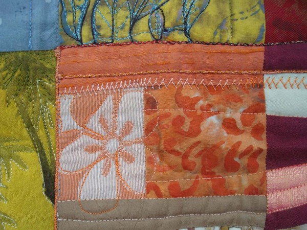 """Can we say this is a """"delicious"""" blend of colors in Eleanor Levie's Pomegranates quilt? Fabrics of citrus colors add to the overall """"flavor"""" of the piece."""