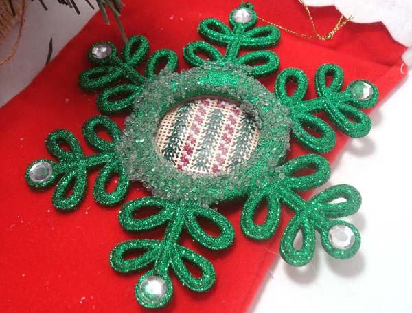 Simple stitches worked in pretty Kreinik metallic threads on perforated paper are inserted into a purchased ornament frame.
