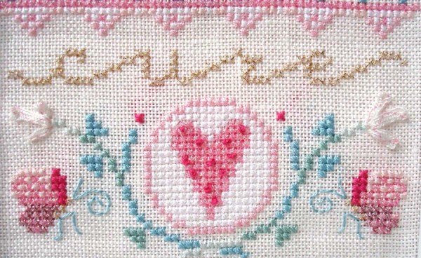 Cross stitched heart from a Breast Cancer Awareness design by Brooke Nolan for Kreinik Manufacturing Company.