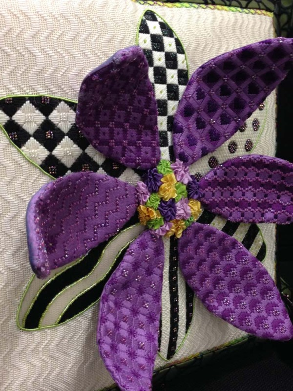 """Pretty in purple, this daisy stands out for...well, standing out. It's called """"3-D Daisy"""" and is from the design company Sew Much Fun. Can you spot the Kreinik metallics?"""