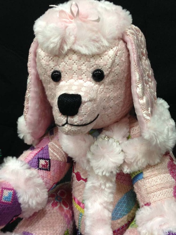 Penelope Poodle is a made by stitching various needlepoint painted canvases and having them finished as a stuffed animal (with movable legs!).