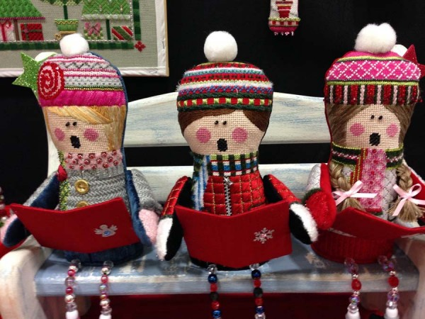 These creative carolers are part of the Christmas ornament series from needlepoint painted canvas design company Sew Much Fun.