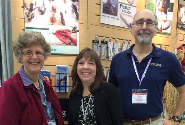 Needlepoint teacher and designer Gay Ann Rogers with Kreinik Creative Director Dena Lenham and thread company owner Doug Kreinik, at a TNNA tradeshow.