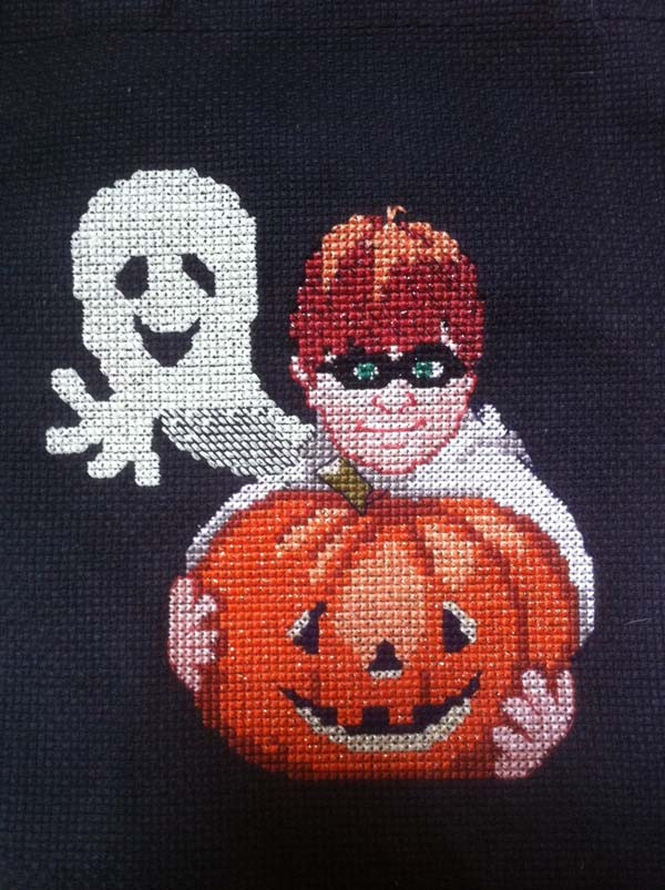 Here's an interesting idea for cross stitching a ghost: work a half-cross stitch for the nebulous vapor-y effect.