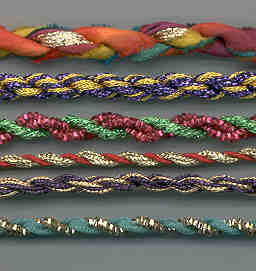 """Here are a few samples of fiber combinations: silk ribbon and Kreinik 1/8"""" Ribbon in the top sample, for instance. You can combine many types of fibers, knitting yarns, Kreinik threads, ribbons, rickrack, etc."""