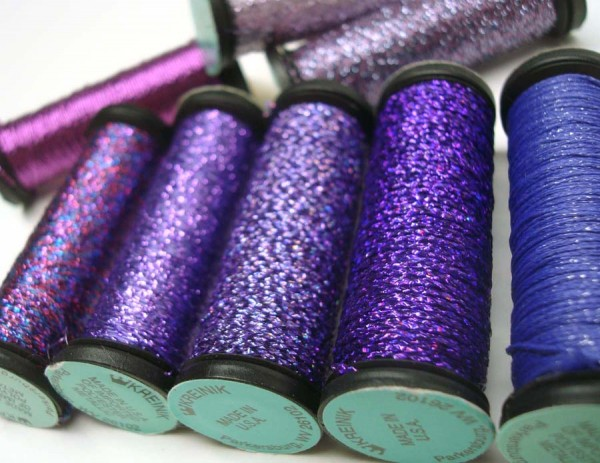 These gorgeous, rich shades of purple are in the form of Kreinik Braid. This brilliant thread is meant to be used alone (not used as a carry-along) to add a bolder metallic look to a design. Washable, dry cleanable, available in several sizes to suit different counts of fabric/canvas and different stitches. Explore more here: http://www.kreinik.com/shops/Metallic-Threads/