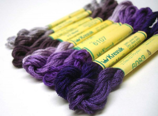 These purple shades are so rich, so regal...and they are featured here in silk thread form. Silk is a natural fiber that takes dyes to the deepest cellular level; that's how you get richer colors than you get with cotton floss (which doesn't take dyes as deeply). Silk is soft as butter, too, just dreamy to use in stitching. Try it for something different; it really isn't that much more expensive, and it's not fragile or hard to use. Silk Mori from Kreinik shown here: http://www.kreinik.com/shops/Silk-Mori-2.5m-Skeins.html