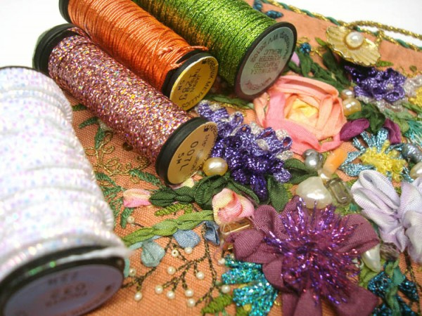 Metallic threads make any stitched flower stand out. Use them to add texture, dimension and light. These threads are from Kreinik, www.kreinik.com.