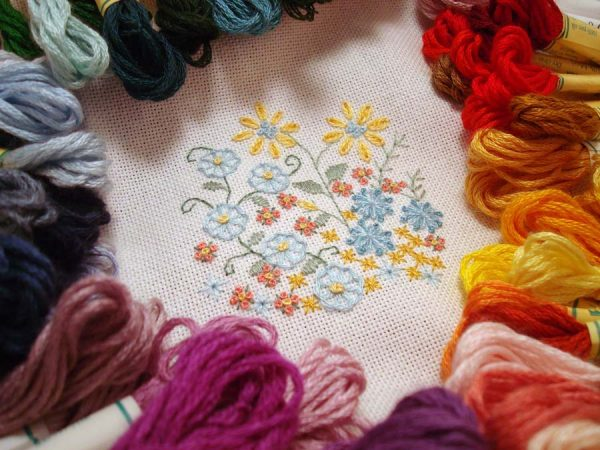 This embroidery sample shows Kreinik Silk Mori, stitched on an evenweave fabric. Use one or more strands of the silk floss depending on your stitches and effect you want to achieve. Pattern available here: http://www.kreinik.com/shops/Enchanted-Garden.html