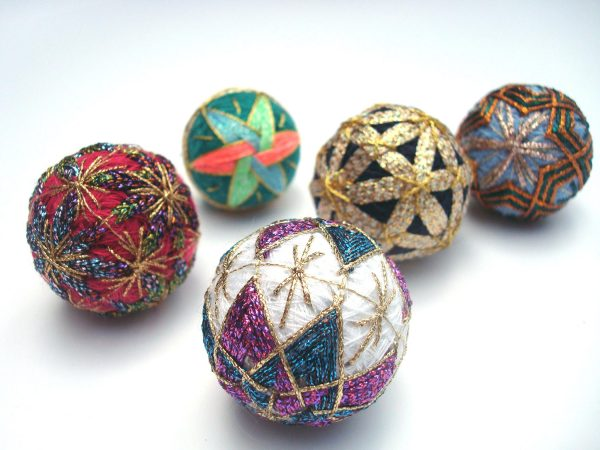 Unfortunately I don't know who made these miniature Temari balls, as they are part of the Kreinik family collection. They are only about an inch to two inches in diameter—mini marvels of Kreinik metallic threads on top of silk and sewing threads.