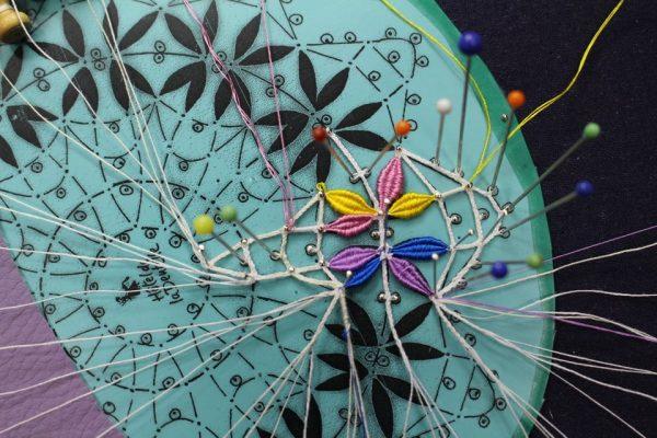 Detail - Colourful handmade Cluny bobbin lace Photo Credit: Elena Kanagy-Loux