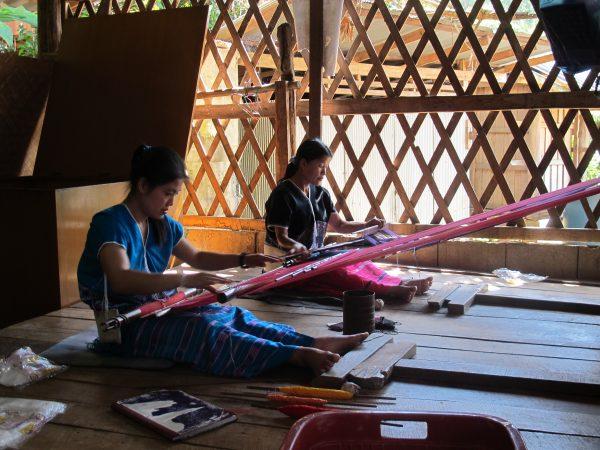 Women weaving at home.