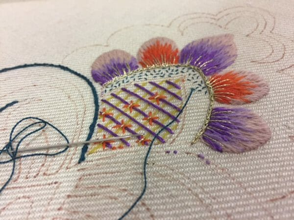 This is Lucy Barter's doodle cloth she worked on during the recent TNNA (The National Needlearts Association) trade show in San Jose California. Can you spot the Kreinik metallic thread?