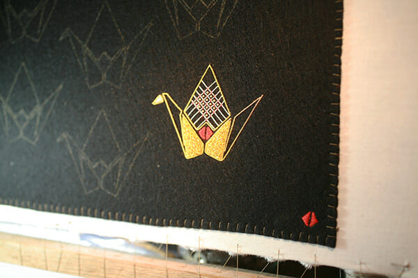 Origami crane in embroidery, by Annalisa Middleton
