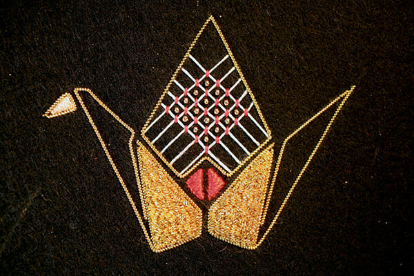 Detail of origami crane in embroidery, by Annalisa Middleton