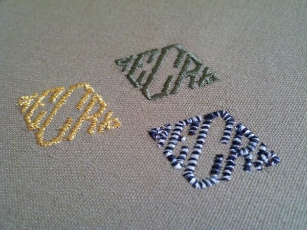 3 monograms stitched in different thread types.