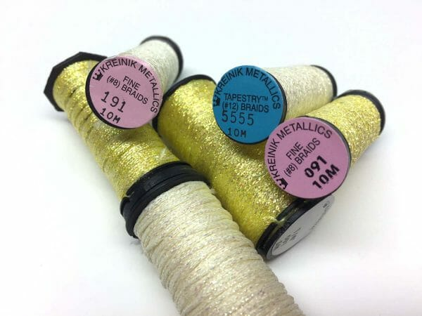 For those who prefer an edgier take on snow stitches, how about, ahem, yellow snow? I like Kreinik color 5555, or 191 or 091.