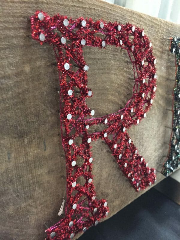 For the most personal string art, add threads in your favorite colors. This monogram uses Kreinik's red Micro Ice Chenille (fuzzy metallic). So fun. Guaranteed no one else has anything like it!