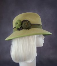 Light green fedora with pleated ribbon ornaments.