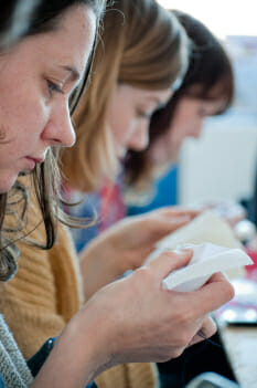 Craftivists in Liverpool reflecting on the issue whilst doing their meditative stitching session.