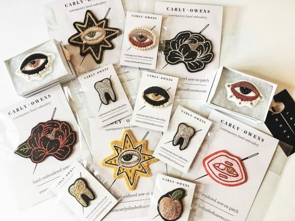 A selection of Carlys patches and pins.