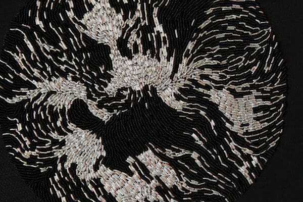 """Carly Owens -""""Duality"""" detail - goldwork on canvas."""