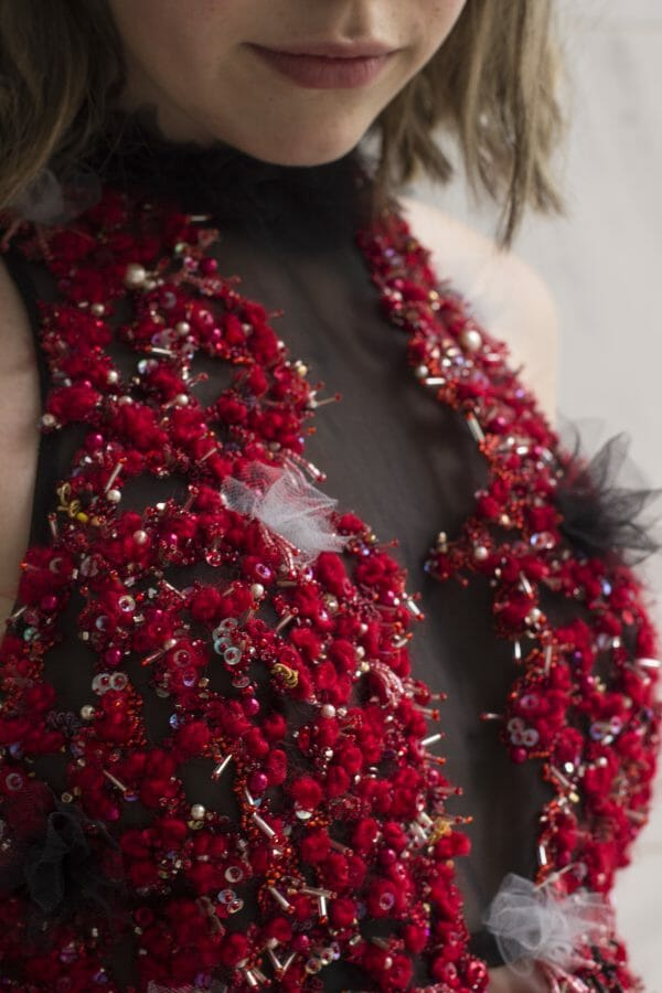 Detail of Carly's hand embroidered dress bodice.