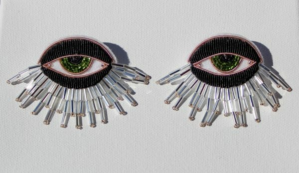 Carly's goldwork eye brooches
