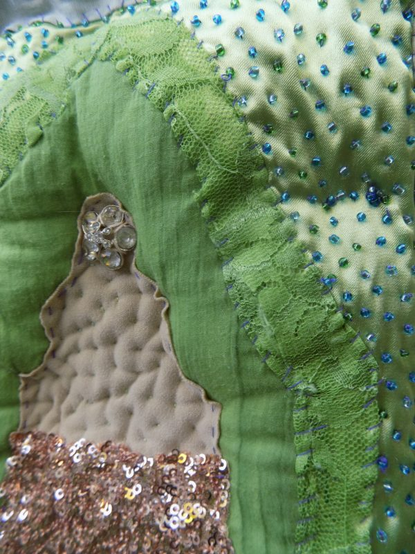 Each panel of Buddha is quilted with a layer of wadding, creating a plinth where he sits in contemplation.