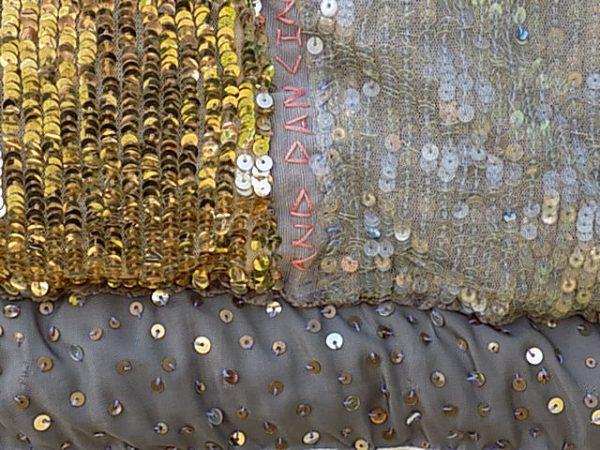 Sequinned fabric creates block colour and light in textile design