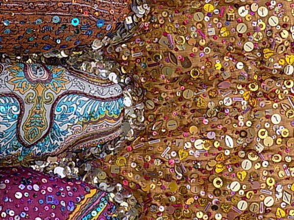 Light reflective beads and sequins enrich a single colour palette