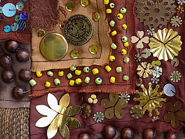 Beads and sequins provide decorative detail in surface embellishment
