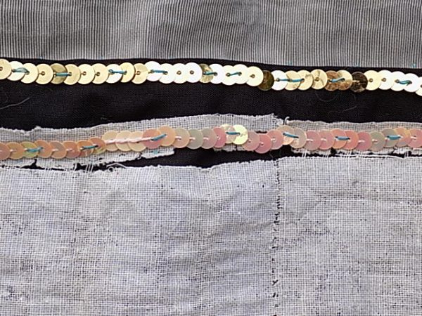 A string of sequins provides delicate detail to a monotone colour palette creating