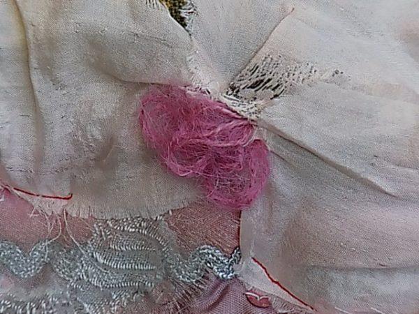 Wool loops provide fragile depth to abstract flowers in 'Angel Wings'