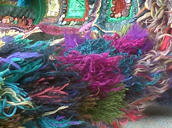 Using wool pompoms to embellish 3D Textile Art with a mobile fringe