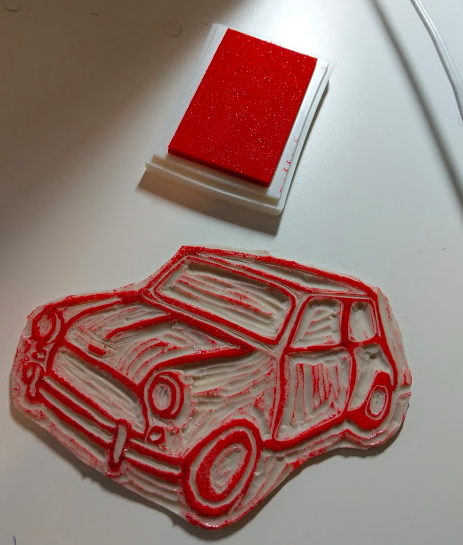 Craft rocks inked up lino