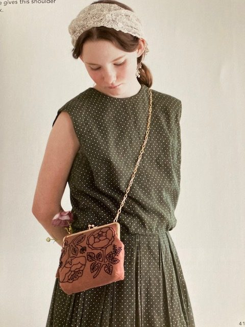 simply stitched, modelled purse